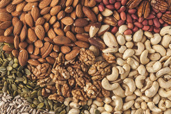 Variety of nuts background, food background, vegan health food concept. Copy space, top view.